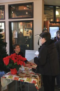 Author Rob Alexander signs book at the Canmore Museum.